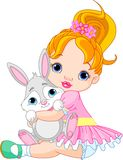 Little girl hugging toy bunny. Cute little girl hugging toy bunny Royalty Free Stock Image