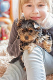Little girl hugging  Yorkshire Terrier Royalty Free Stock Images