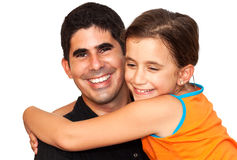 Little girl hugging a young latin man Royalty Free Stock Image