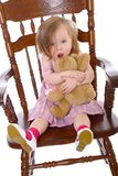 Little girl huging a bear Stock Photos