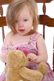Little girl huging a bear Stock Photography