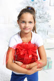 Little girl hugs a gift Stock Photos