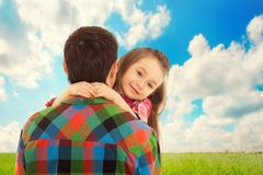 Little Girl hugs her father. Fathers day, family holiday, vacation royalty free stock image