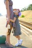 Little girl hugs her mom Stock Photography