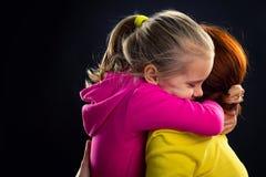 Little girl hugs her mother Royalty Free Stock Image