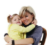 Little girl hugs the young mother Royalty Free Stock Photos