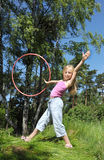 Little girl  with hula hoop Royalty Free Stock Image
