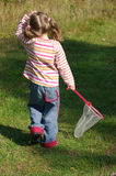 Girl hunting butterflies Royalty Free Stock Image