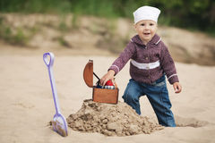 Little girl hunting for treasure Stock Photography