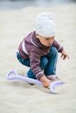 Little girl hunting for treasure Stock Image