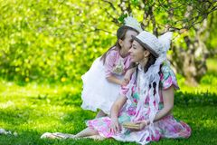 Mother and daughter in a summer park. stock photos
