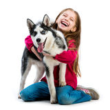 Little girl is with husky dog Stock Images