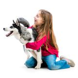 Little girl is with husky dog Royalty Free Stock Photos