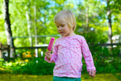 Little girl with ice-cream Royalty Free Stock Images