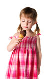 Little girl with the ice-cream. Cute little girl with the ice-cream on a white background Royalty Free Stock Photo