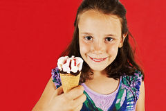 Little girl with ice cream. In studio isolated Royalty Free Stock Photo