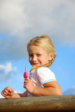 Little girl with ice-cream Stock Photos