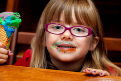 Little Girl with Ice Cream Cone and Messy Face Royalty Free Stock Photography