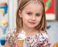 Little girl with ice cream. Cute little girl with ice cream, looking into camera Royalty Free Stock Photography
