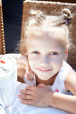 Little girl with ice cream milk shake outdoor Stock Photos