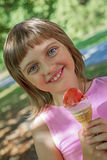 Little girl with ice cream Stock Photos