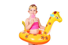 Little girl with ice cream and swimming rubber Stock Image