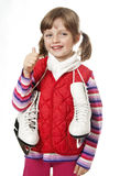 little girl with ice skates Stock Images