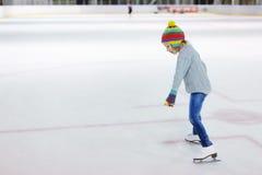 Little girl ice skating Stock Photo