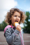Little girl with icecream in the park Stock Photos