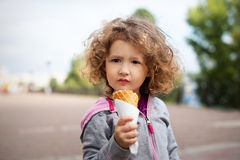 Little girl with icecream in the park Royalty Free Stock Image