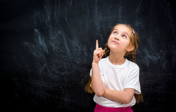Little girl with the idea Royalty Free Stock Photo
