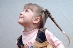 LITTLE_GIRL III. A girl with her hair plaited Stock Photo