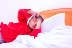 Little girl with illness on the bed Royalty Free Stock Images