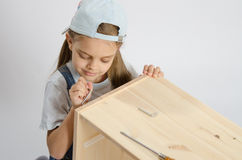 Little girl in the image of garbage furniture spins Royalty Free Stock Photo
