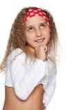 Little girl imagines. A little girl imagines on the white background royalty free stock photo