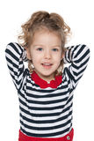 Little girl imagines. A little girl imagines against the white background stock photography
