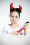 Little girl in imp suit. Portrait of little girl in imp suit Royalty Free Stock Photo
