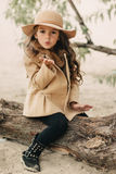 Little Girl In A Hat With Long Hair Royalty Free Stock Photos
