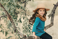 Little Girl In A Hat With Long Hair Royalty Free Stock Photography