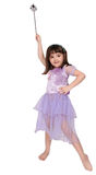 Little Girl In Costume Waving Wand Isolated Stock Photo