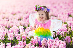 Free Little Girl In Fairy Costume Playing In Flower Field Stock Photography - 89982562