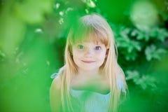 Free Little Girl In Park Wearing Blue Dress Stock Photo - 14707350