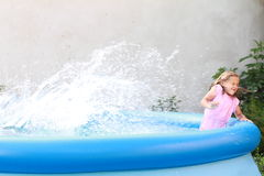 Little Girl In Pool Stock Photo