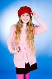 Little Girl In Red Cap Stock Photo