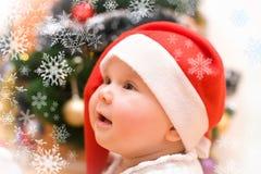 Little Girl In Red Santa Hat Stock Photo