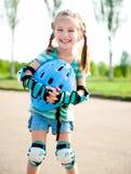 Little Girl In Roller Skates Stock Images