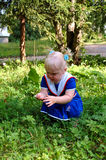 Little Girl In Sailor Blue Dress Walk In The Park. Royalty Free Stock Photos