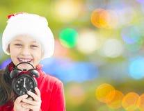 Little Girl In Santa Claus Hat Stock Photos