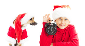 Little Girl In Santa Claus Hat Holding Alarm Clock Showing Twelv Royalty Free Stock Photography