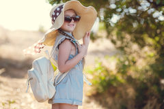 Little Girl In Straw Hat,traveling Alone In The Summer Royalty Free Stock Image